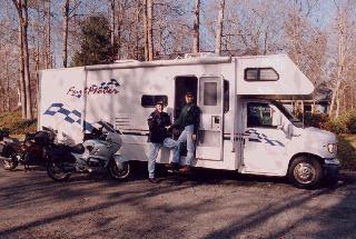 A picture of Christine and Joe in front of their RV.